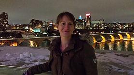 Kari with the Minneapolis Stone Arch Bridge in teh background
