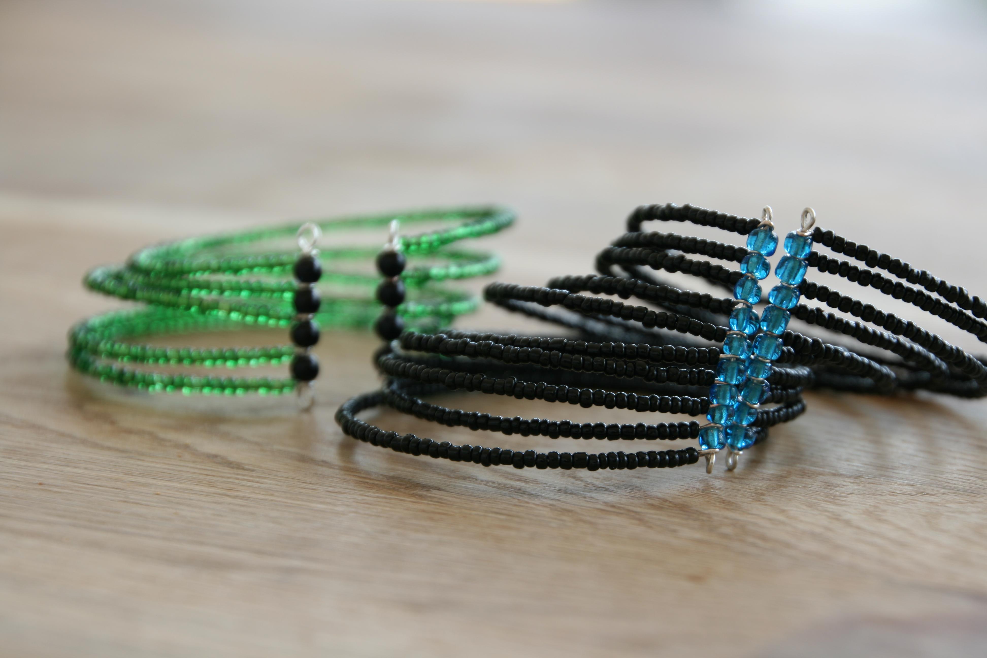 Multi-strand cuff bracelets.