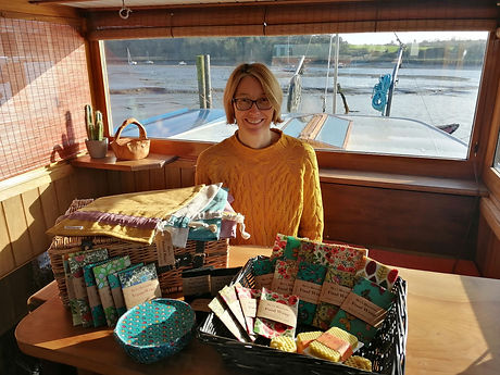 Bev Rogers in the wheelhouse of her Dutch Barge, Tijdstroom with her Bevs Eco Products collection Tijdstroom