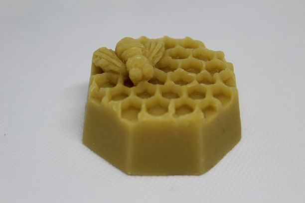 A 50g honeycomb shaped bar of beeswax an