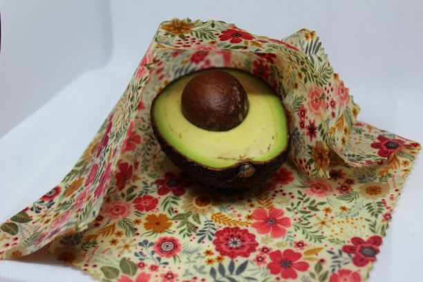 A medium floral wax wrap covering an avo