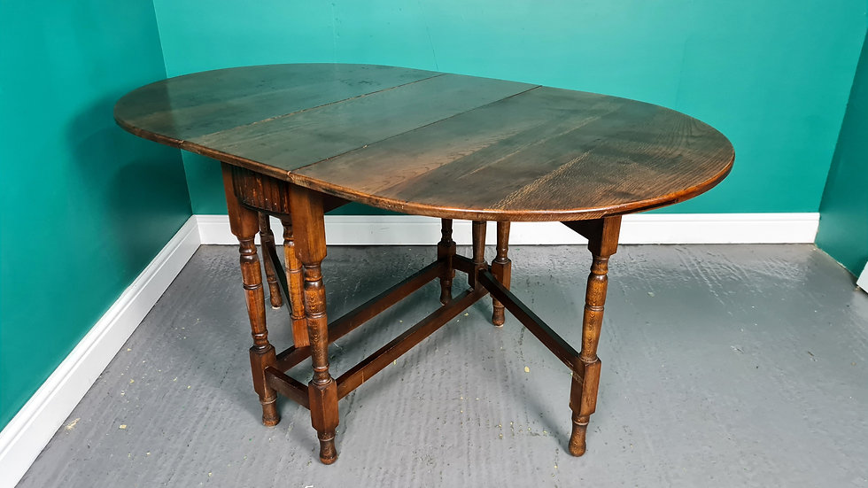 An Antique Style Solid Oak Drop Leaf Dining Table ~Delivery Available~