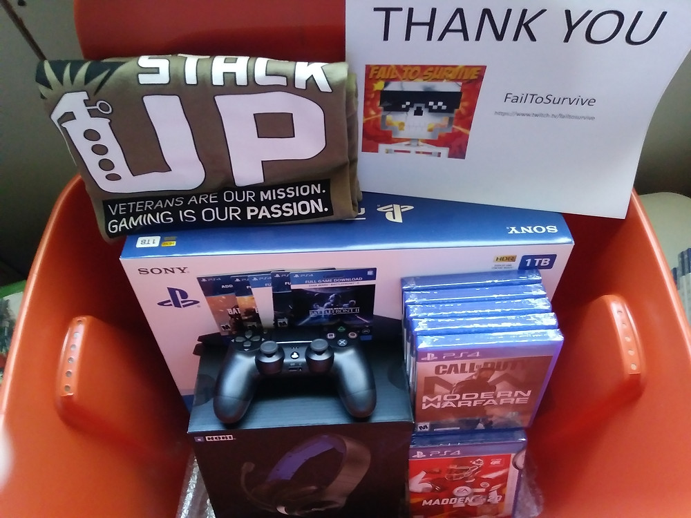 Yet another Supply Crate picture. It has the PlayStation 4, Thank You note, Stack Up T-shirt, and PS4 games and accessories in it.
