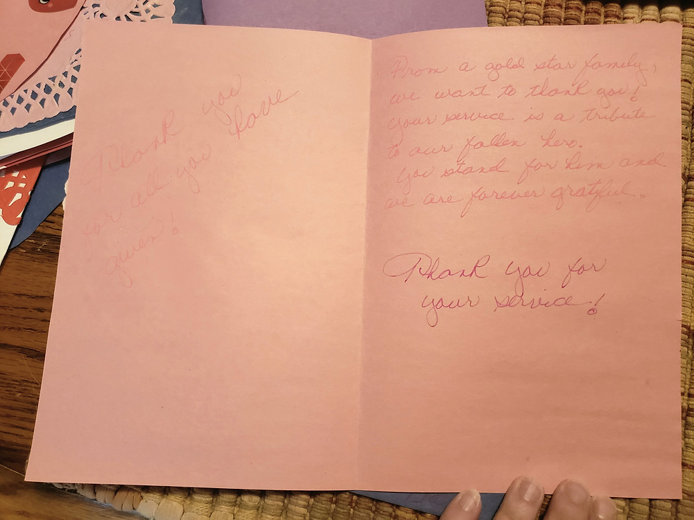 An open valentines card shows the thank you message for the receiver. It is difficult to read.