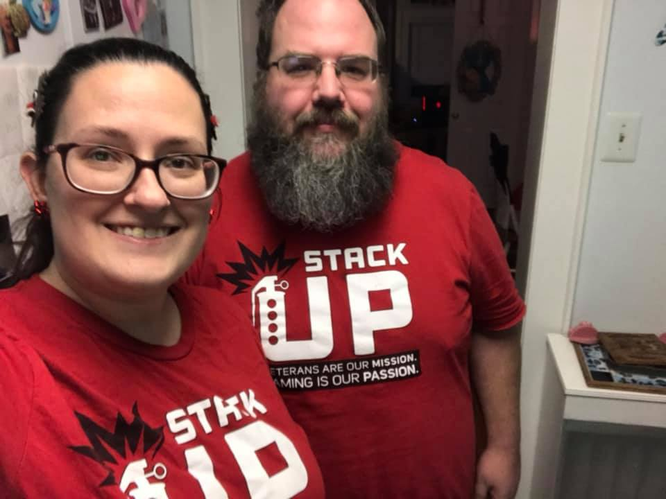 Two stack up stacks members smile while wearing their red stack up t shirts.
