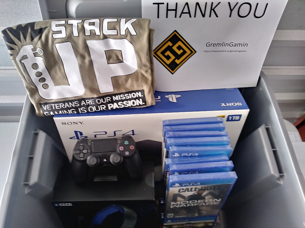 Picture of Supply Crate with Playstation 4, PS4 games, an extra PS4 controller and two Army green Stack Up t-shirts. Thank you note is to GreminGamin.