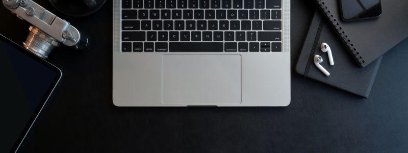 Working desk | Laptop | Camera | Optimize Blog Posts | Skribu Digital