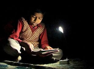 boy-studying-with-solar-LED-light.jpg