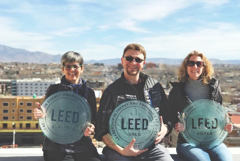 Noreen Richards, Josh Wishart, Kris Callori in front of Albuquerque skyline