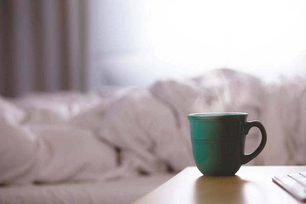 Green coffee mug on table
