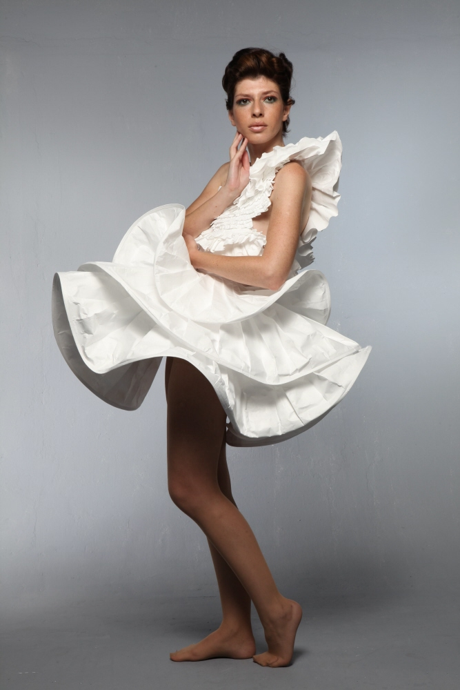 Woman wearing a dress made of Tyvek.