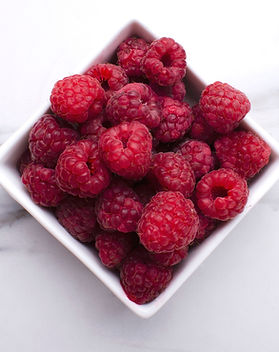 Top view of fresh and juicy rasberries i