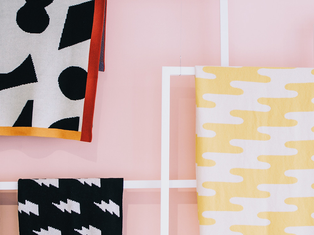 graphic print fabric hanging against pink wall