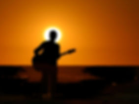 PLAYING-GUITAR-IN-SUNSET-BACKGROUND.jpg