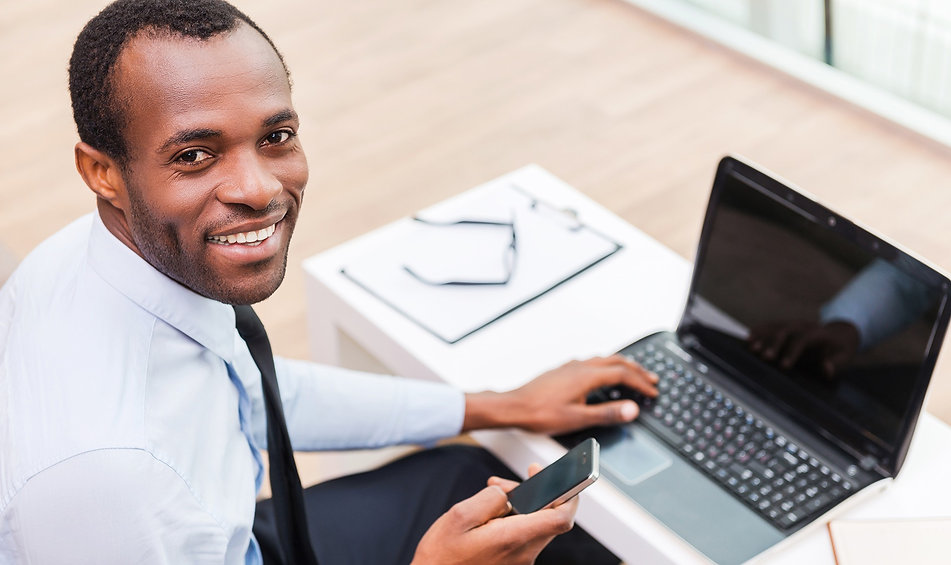 Smiling%20Man%20on%20Laptop_edited.jpg