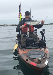 Kayak fishman with an albie