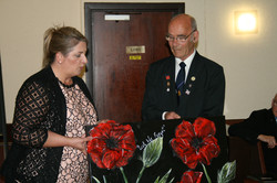 Denise nee Macdonald presenting the Chairman with a collage of poppies.