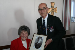 Eric Duguid Presenting a framed photograph to the Great Neice of Cpl. William Anderson