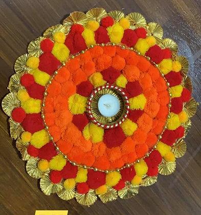 Pom pom rangoli mat with T-light
