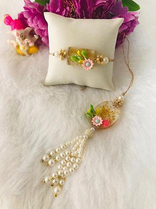 Beautiful resin pearl rakhi & lumba pair