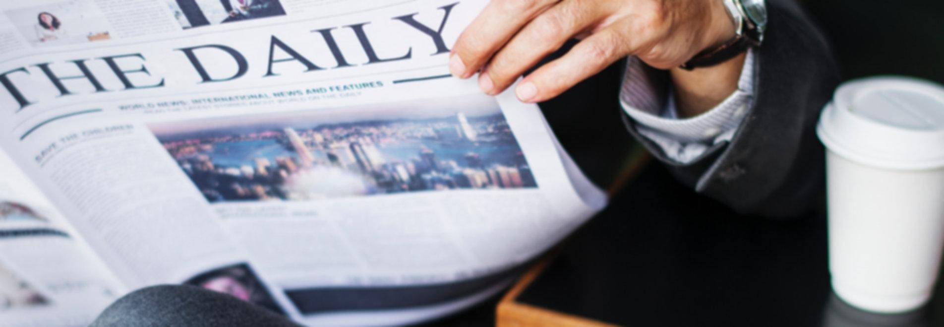 Reading%2520a%2520Newspaper_edited_edite