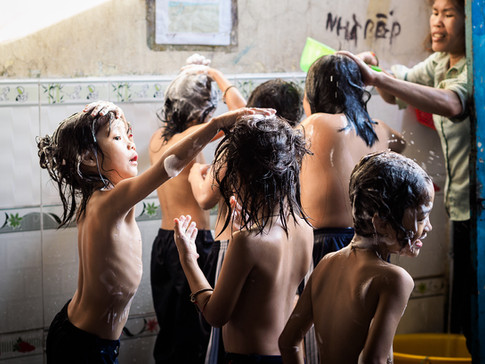 Orphan boys taking shower at Buu Tri pagoda, Can Tho