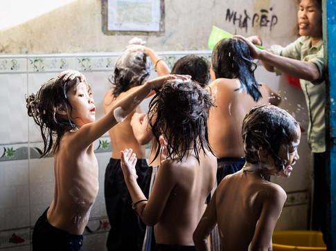 Orphan boys taking shower at Buu Tri pagoda, Can Tho