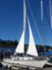 Mary Jo Wiseman and sailboat, The Unity_300 px w