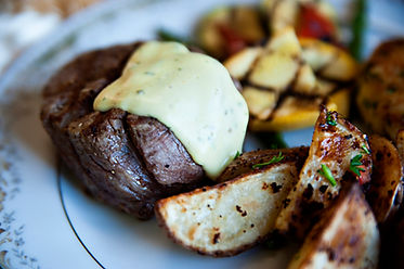 Filet Mignon, roated potatoes, and grilled vegetables.