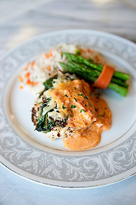 Chicken Stack, Rice Pilaf, and Asparagus Bundle.,