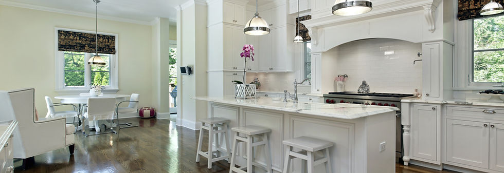 Large kitchen in luxury home with white