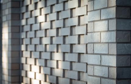 Recess brick detail of mixed-use new build.
