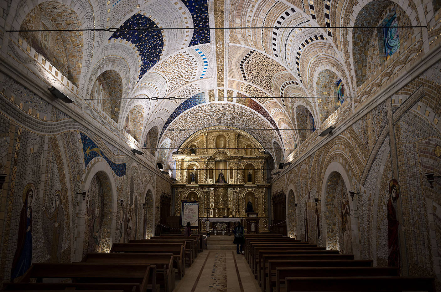 The interior of the church in Polloc, Peru is covered in mosaic tiles of marble, stone, gold leaf, glass, and other materials depicting scenes from the life of Christ.