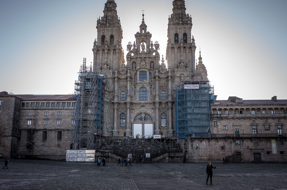 An early arriving pilgrim takes a selfie in front of the cathedral in Santiago de Compostela.