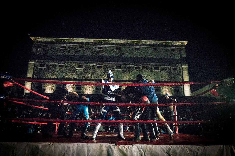 An amateur lucha libre match takes place despite the rain on a Saturday night in Guanajuato.
