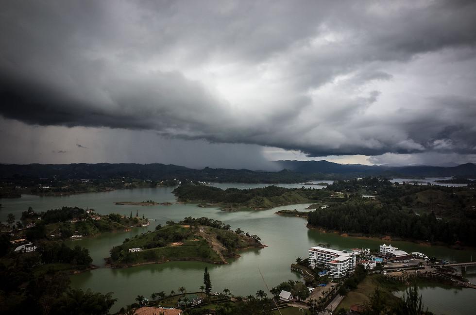 A storm dumps rain in the hills surrounding the Peñol reservoir, a manmade lake in eastern Antioquia.