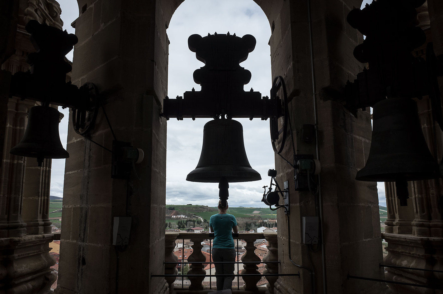 A pilgrim looks out over the city from the bell tower in Santo Domingo del la Calzado.