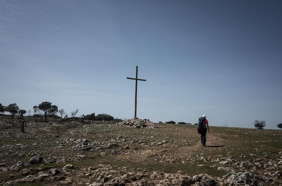 A cross in the rocky fields east of Burgos.