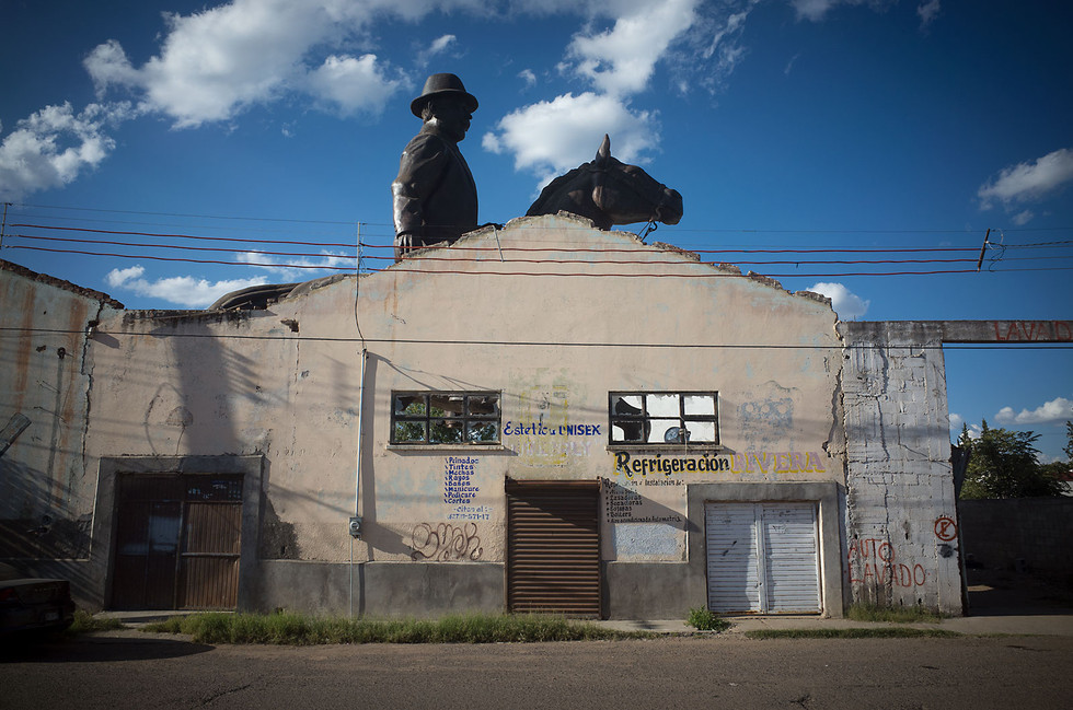 """An enormous statue of Francisco """"Pancho"""" Villa sits behind the wall of an abandoned building in Hidalgo del Parral. The city has a special affection for the famed revolutionary, who spent his later years near the city and was assassinated in its streets in 1923. Parral boasts a museum dedicated to Villa as well as an annual reenactment of his death."""