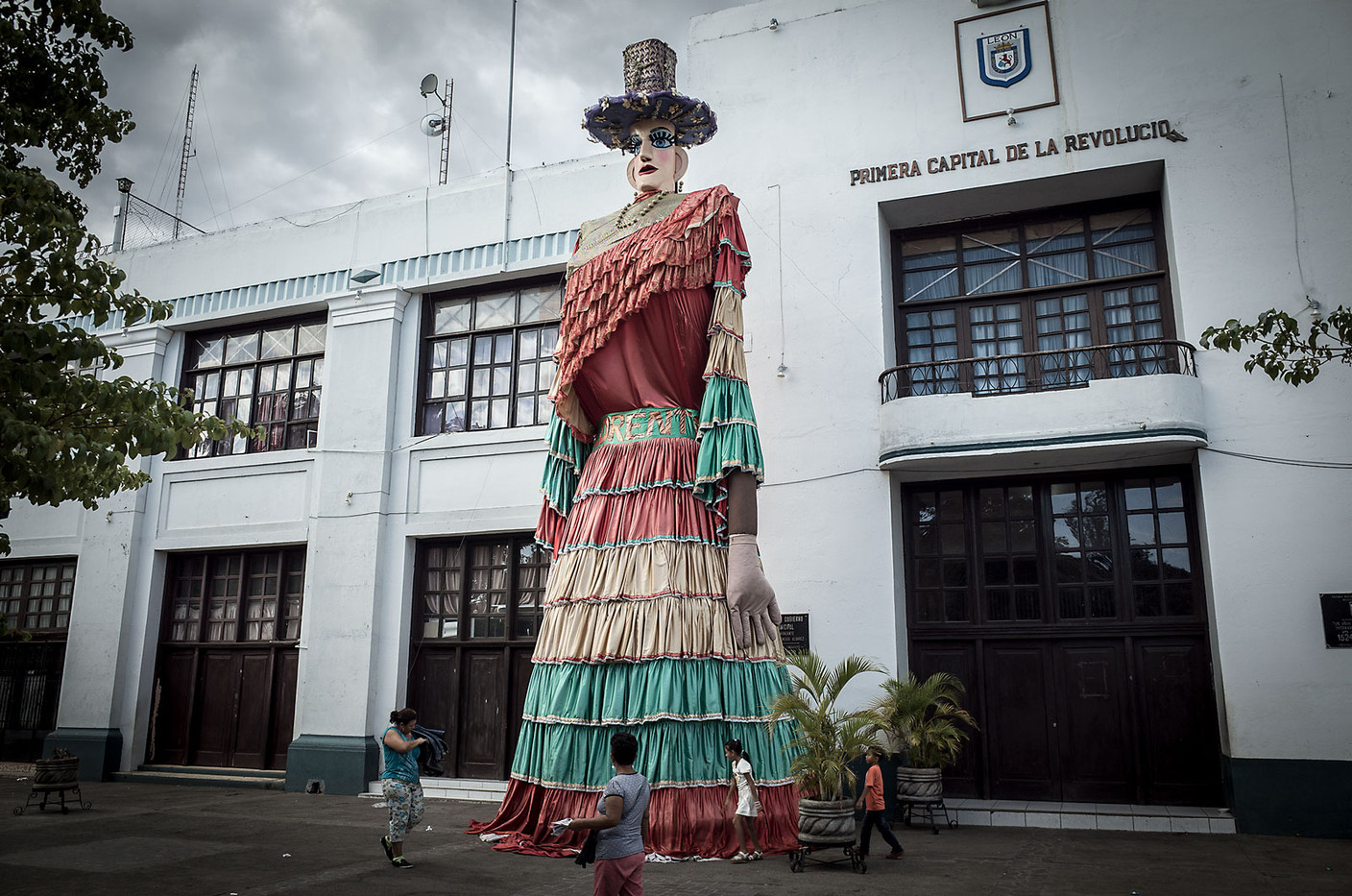 A statue of La Gigantona sits in the square in León, Nicaragua. La Gigantona is part of traditional Nicaraguan celebrations and pejoratively depicts a colonial Spanish women: tall, pale, and haughty. She is accompanied by El Enano Cabezon (The Big-Headed Dwarf), a short indigenous man, his oversized head representing his superior intelligence.