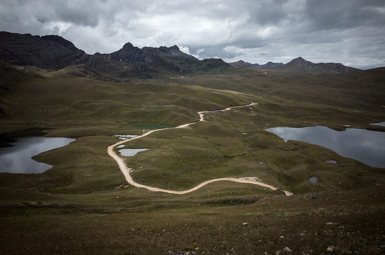 Route LI 115 cuts through a barren mountain landscape south of Huamachuco.