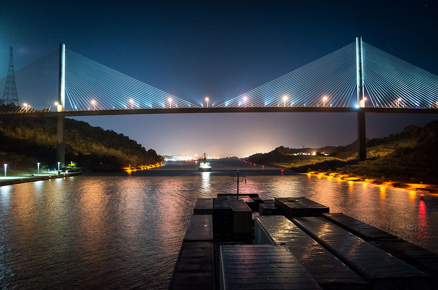 View from the helm of a container ship as it passes under the Centennial Bridge across the Panama Canal. The bridge is two kilometers north of the locks at Pedro Miguel.