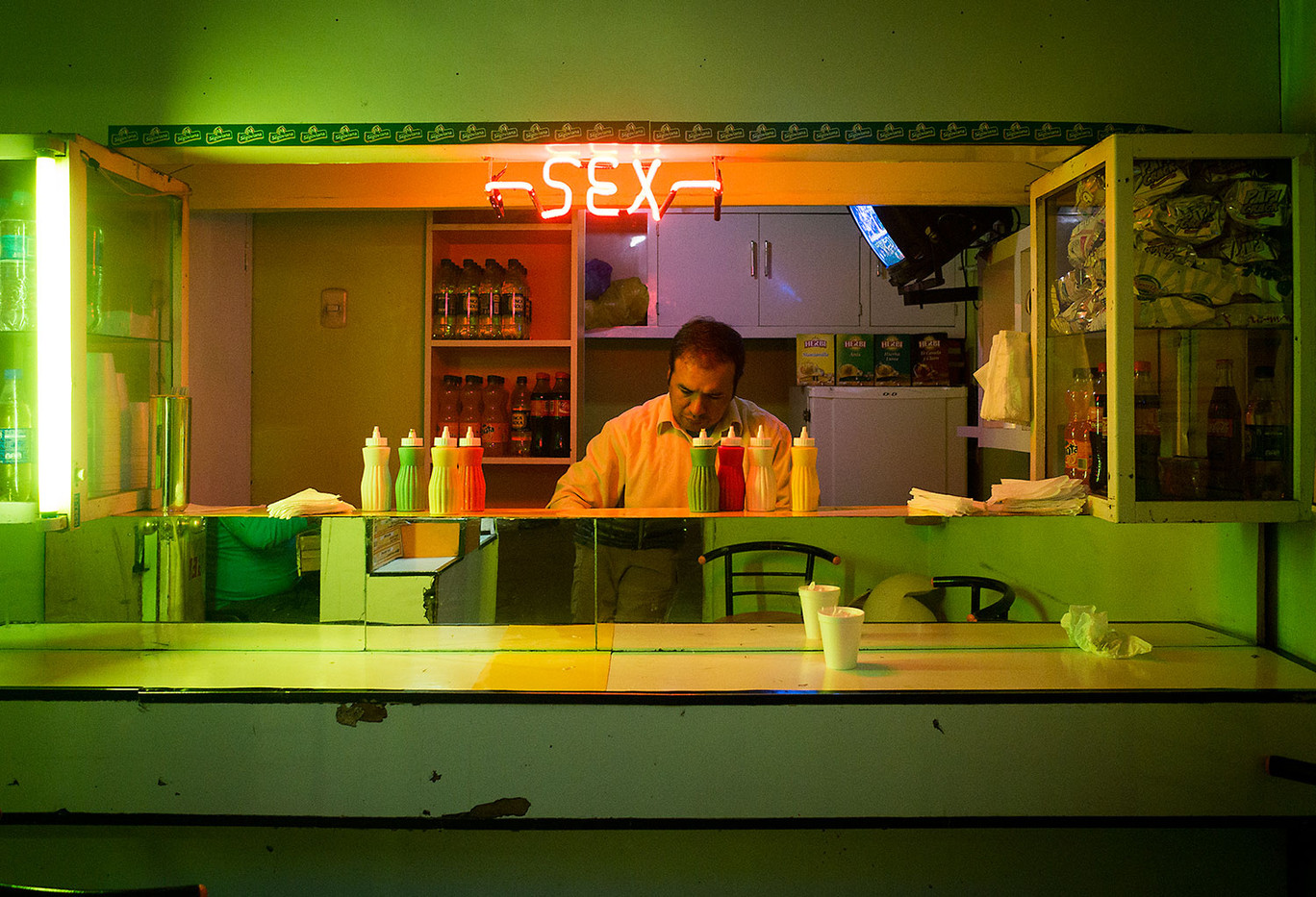 A cook piles on the final layers of a #8 at Sex Burger in Huaraz.