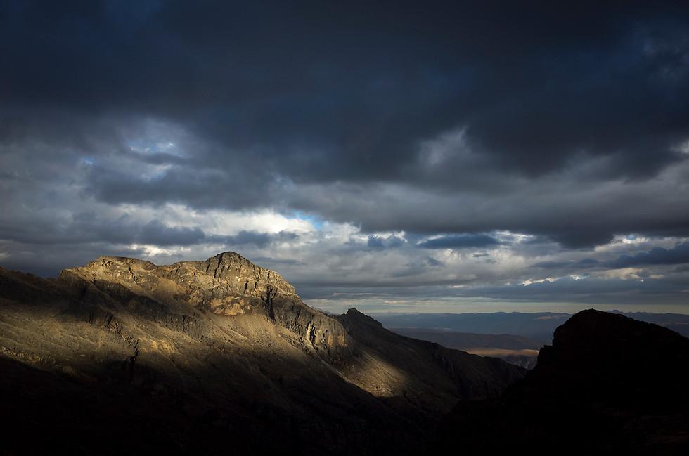 Spots of sunlight strike an unnamed ridge in Llaca valley.