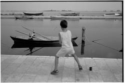 Greek Boy Fishing - by David Peat