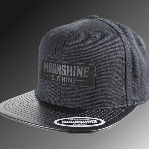 Moonshine Black Label/Black Snapback/Leather Patch