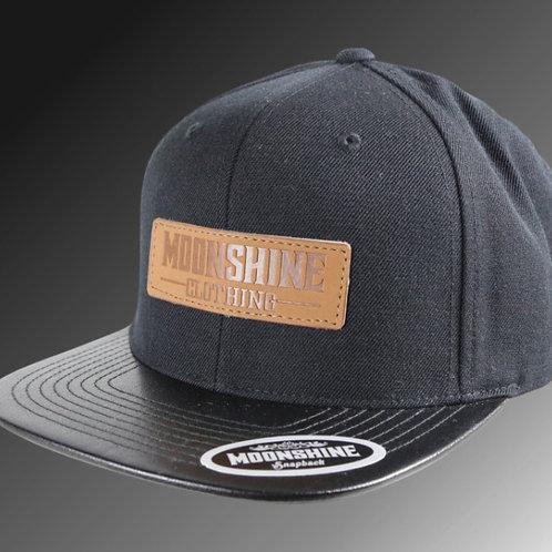Moonshine - Black / Black Snapback / Leather Patch