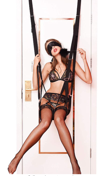 A blindfolded woman sitting on a BDSM swing