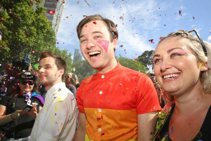 Photo: There were thrilled smiles at a Yes event in Melbourne. (ABC News: Margaret Burin)