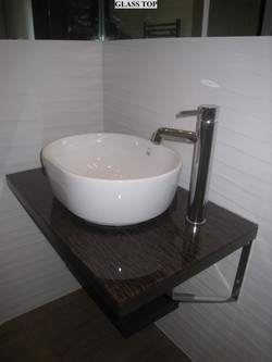Wall mounted sink with mixer tap